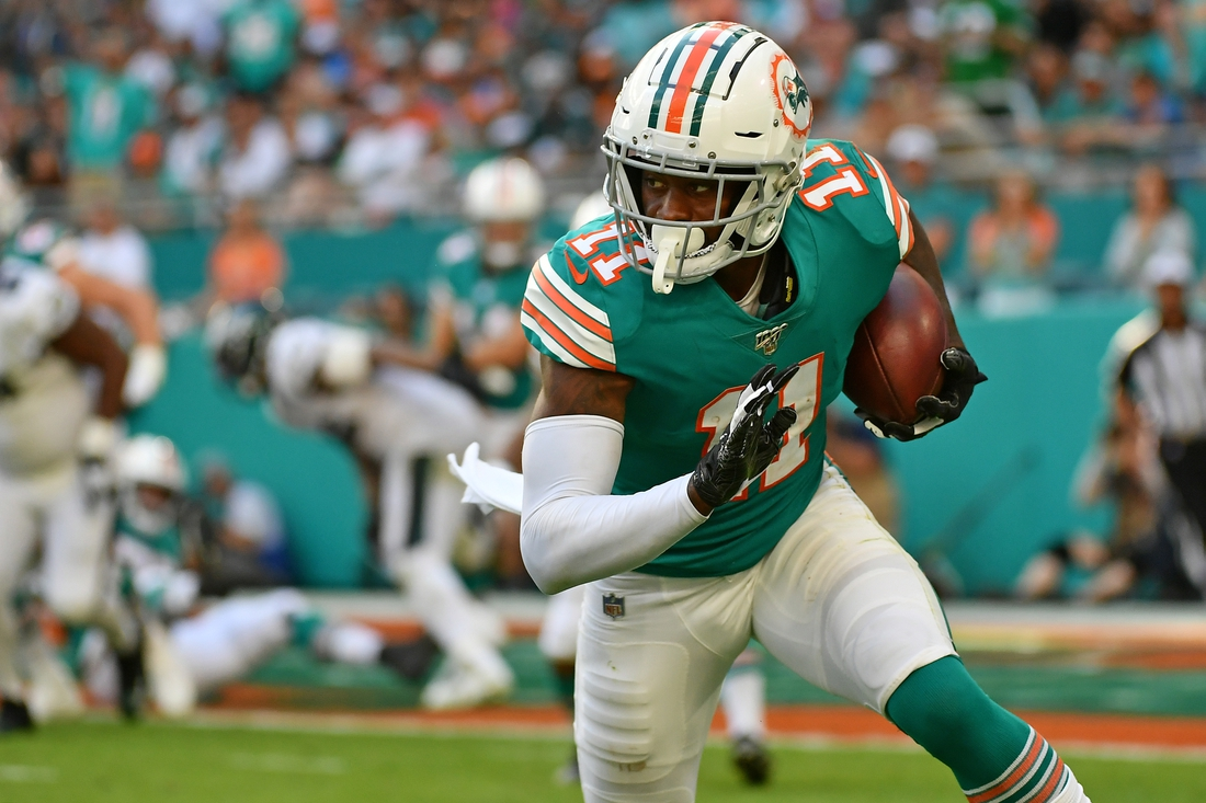 Dec 1, 2019; Miami Gardens, FL, USA; Miami Dolphins wide receiver DeVante Parker (11) runs the ball after a catch during the second half against the Philadelphia Eagles at Hard Rock Stadium. Mandatory Credit: Jasen Vinlove-USA TODAY Sports