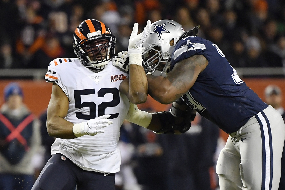 Dec 5, 2019; Chicago, IL, USA; Chicago Bears outside linebacker Khalil Mack (52) rushes against Dallas Cowboys offensive tackle Tyron Smith (77) in the second half at Soldier Field. Mandatory Credit: Quinn Harris-USA TODAY Sports