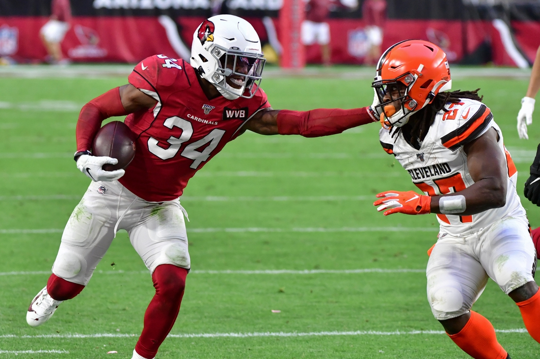 Dec 15, 2019; Glendale, AZ, USA; Arizona Cardinals safety Jalen Thompson (34) carries the ball after recovering a fumble as Cleveland Browns running back Kareem Hunt (27) defends during the second half at State Farm Stadium. Mandatory Credit: Matt Kartozian-USA TODAY Sports