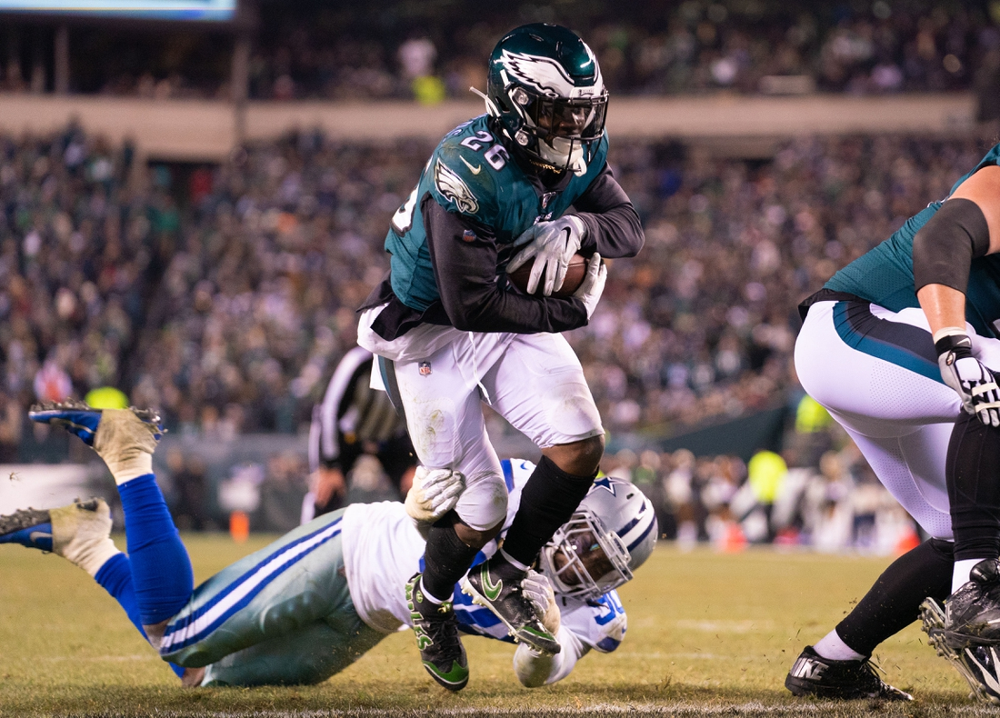 Dec 22, 2019; Philadelphia, Pennsylvania, USA; Philadelphia Eagles running back Miles Sanders (26) runs for a touchdown past Dallas Cowboys cornerback Anthony Brown (30) during the third quarter at Lincoln Financial Field. Mandatory Credit: Bill Streicher-USA TODAY Sports