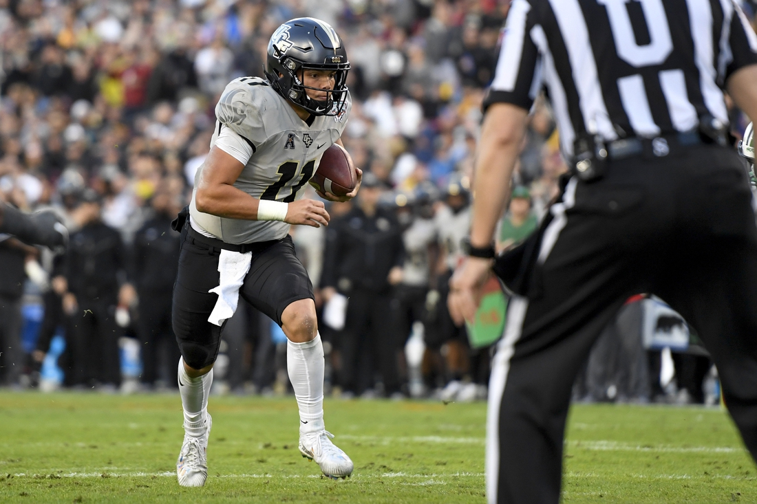 Dec 23, 2019; Tampa, Florida, USA; Central Florida Knights quarterback Dillon Gabriel (11) runs the ball in for a touchdown during the third quarter against the Marshall Thundering Herd at Raymond James Stadium. Mandatory Credit: Douglas DeFelice-USA TODAY Sports