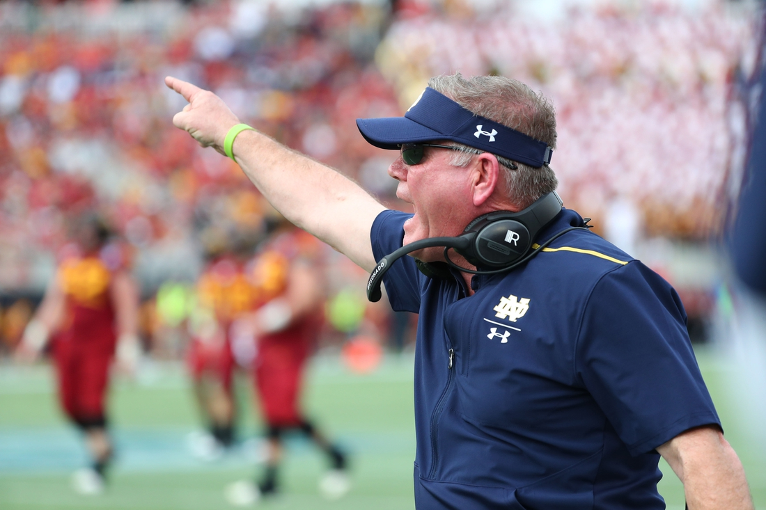 Dec 28, 2019; Orlando, Florida, USA; Notre Dame Fighting Irish head coach Brian Kelly reacts against the Iowa State Cyclones during the second half at Camping World Stadium. Mandatory Credit: Kim Klement-USA TODAY Sports