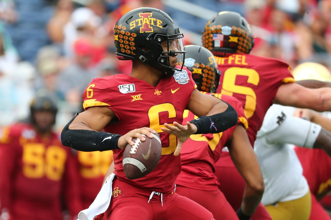 Dec 28, 2019; Orlando, Florida, USA; Iowa State Cyclones quarterback Re-al Mitchell (6) throws the ball against the Notre Dame Fighting Irish during the second half at Camping World Stadium. Mandatory Credit: Kim Klement-USA TODAY Sports