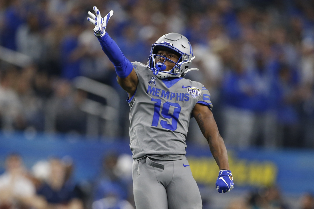 Dec 28, 2019; Arlington, Texas, USA; Memphis Tigers running back Kenneth Gainwell (19) reacts to a first down in the third quarter against the Penn State Nittany Lions at AT&T Stadium. Mandatory Credit: Tim Heitman-USA TODAY Sports