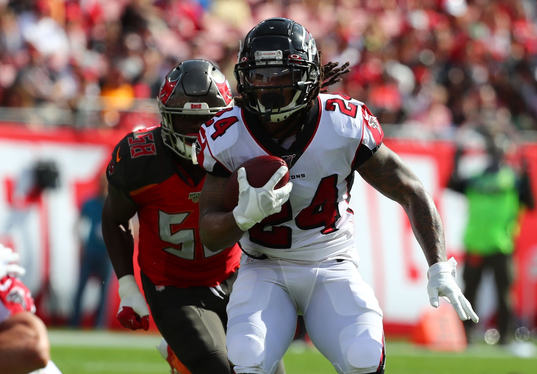 Dec 29, 2019; Tampa, Florida, USA; Atlanta Falcons running back Devonta Freeman (24) runs with the ball against the Tampa Bay Buccaneers during the first quarter at Raymond James Stadium. Mandatory Credit: Kim Klement-USA TODAY Sports