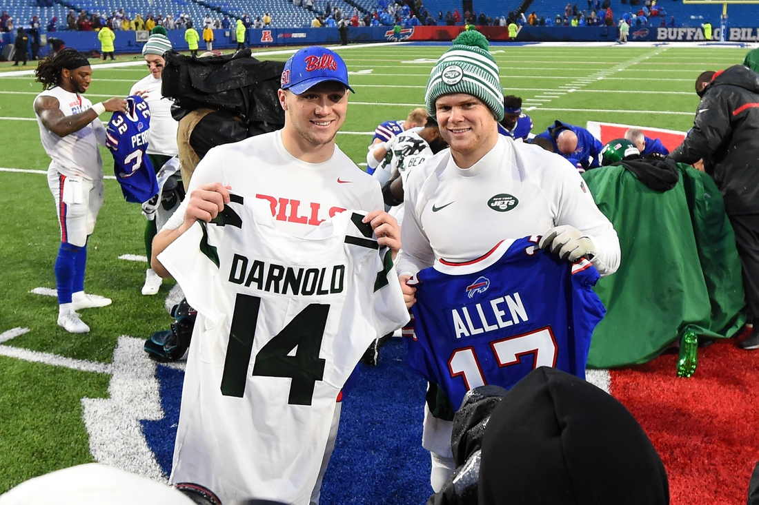 Dec 29, 2019; Orchard Park, New York, USA; New York Jets quarterback Sam Darnold (right) and Buffalo Bills quarterback Josh Allen (left) pose for a photo after a jersey exchange following the game at New Era Field. Mandatory Credit: Rich Barnes-USA TODAY Sports