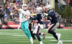 Dec 29, 2019; Foxborough, Massachusetts, USA; Miami Dolphins quarterback Ryan Fitzpatrick (14) throws a pass past New England Patriots free safety Devin McCourty (32) and outside linebacker Dont'a Hightower (54) during the second half at Gillette Stadium. Mandatory Credit: Bob DeChiara-USA TODAY Sports
