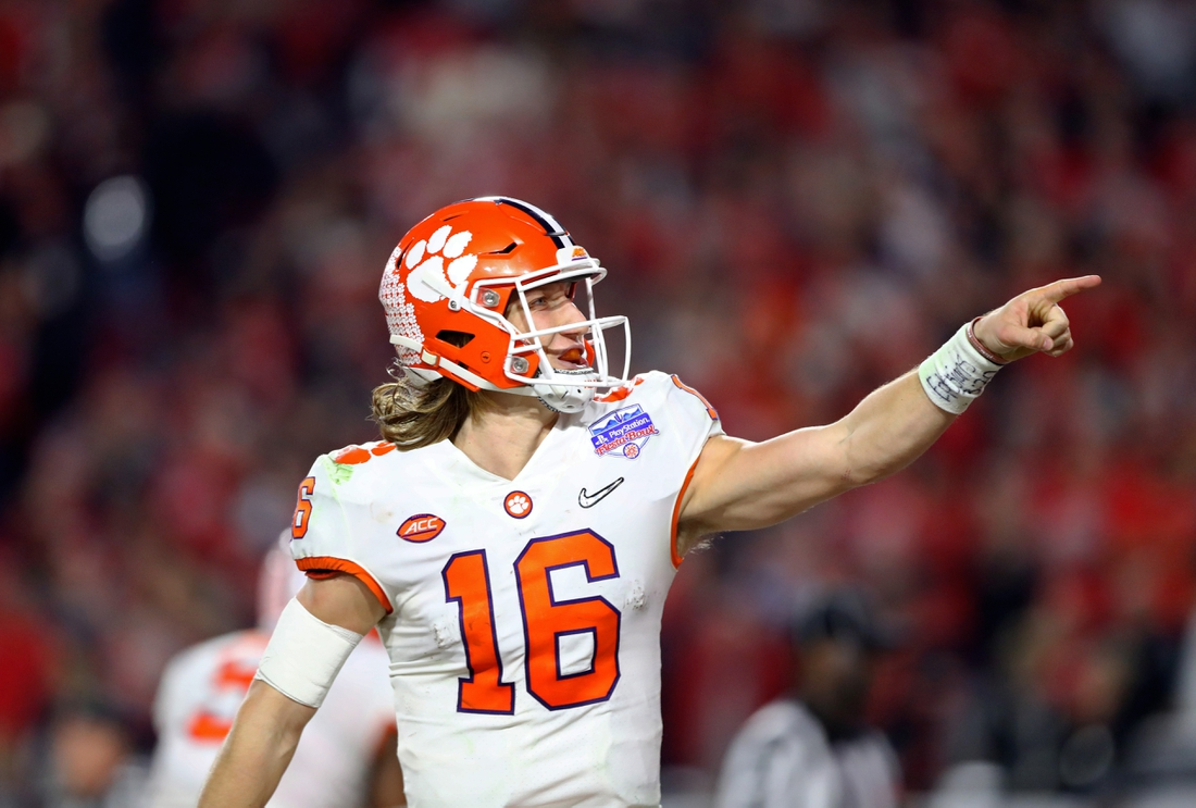 Dec 28, 2019; Glendale, AZ, USA; Clemson Tigers quarterback Trevor Lawrence (16) celebrates a touchdown in the 4th quarter against the Ohio State Buckeyes in the 2019 Fiesta Bowl college football playoff semifinal game at State Farm Stadium. Mandatory Credit: Mark J. Rebilas-USA TODAY Sports