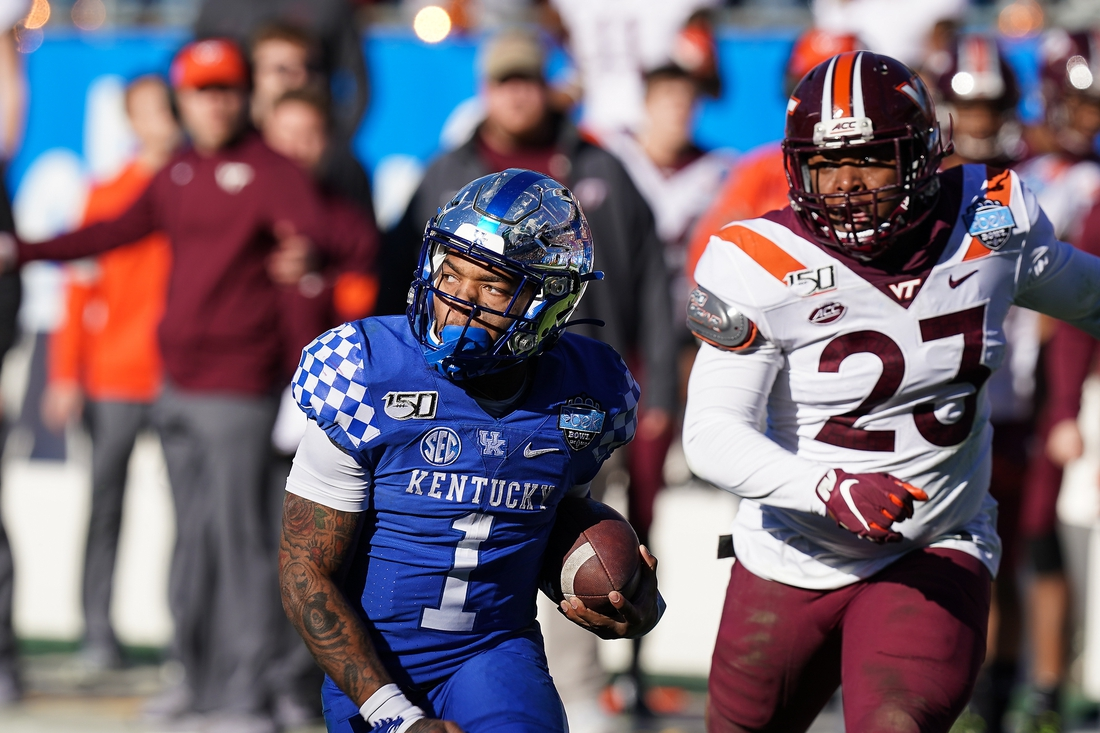 Dec 31, 2019; Charlotte, North Carolina, USA;  Kentucky Wildcats quarterback Lynn Bowden Jr. (1) heads for the end zone followed by Virginia Tech Hokies linebacker Rayshard Ashby (23) during the second half of the Belk Bowl at Bank of America Stadium. Mandatory Credit: Jim Dedmon-USA TODAY Sports