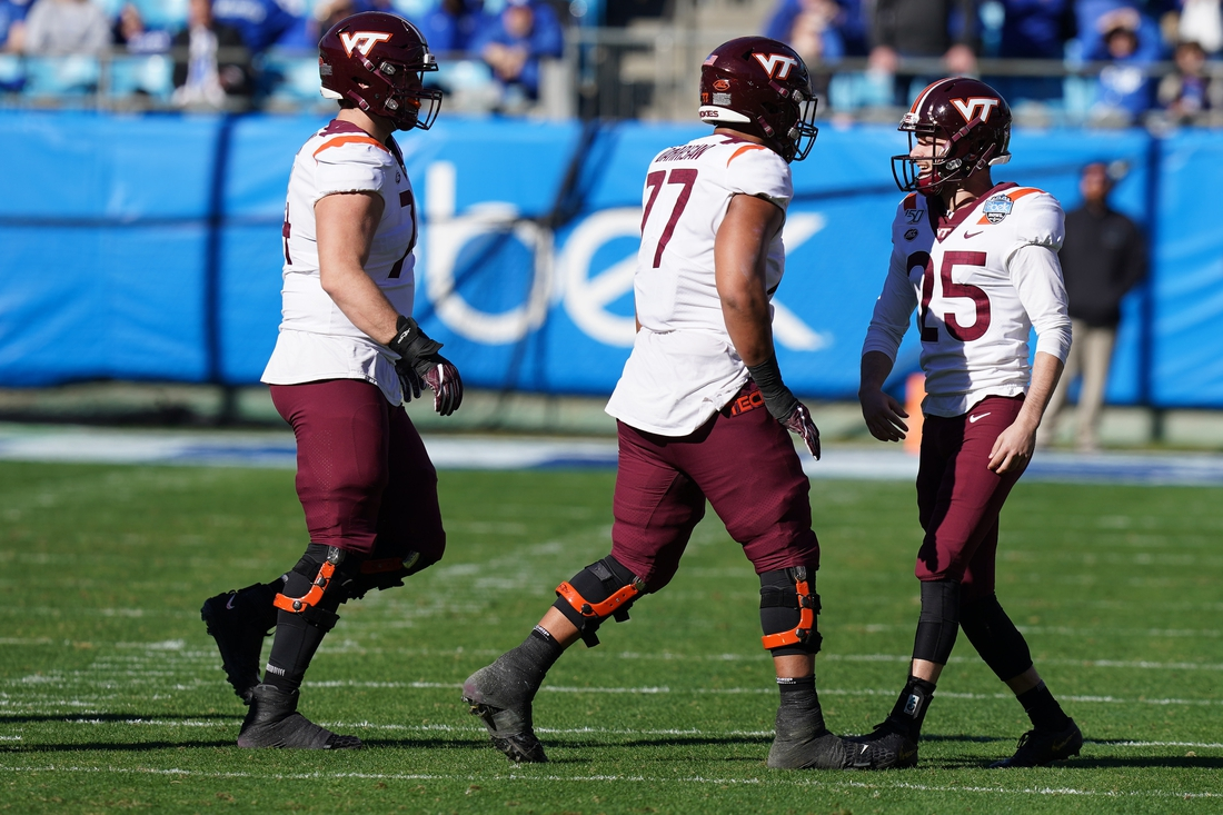 Dec 31, 2019; Charlotte, North Carolina, USA;  Teammates celebrate with Virginia Tech Hokies place kicker Brian Johnson (93) after a 54 yard field goal during the first quarter of the Belk Bowl at Bank of America Stadium. Johnson was wearing a special (25) jersey number in honor of Frank Beamer. Mandatory Credit: Jim Dedmon-USA TODAY Sports