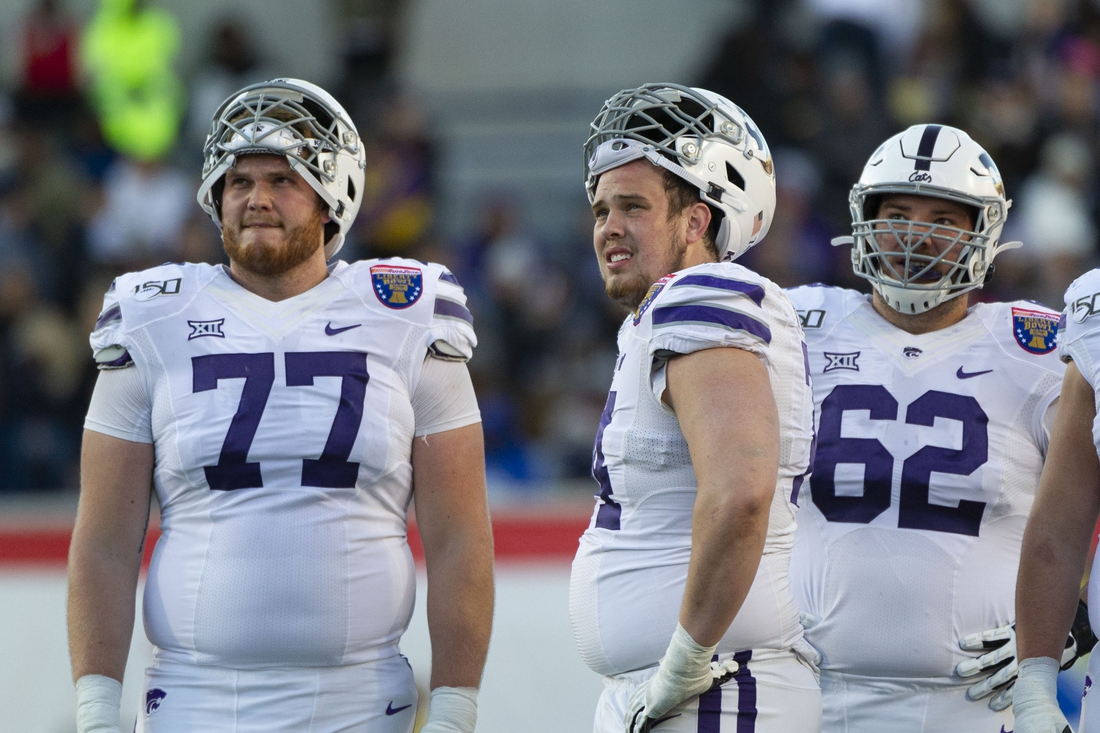 Dec 31, 2019; Memphis, Tennessee, USA; Kansas State Wildcats players react during the first half against the Navy Midshipmen  at Liberty Bowl Memorial Stadium. Mandatory Credit: Justin Ford-USA TODAY Sports