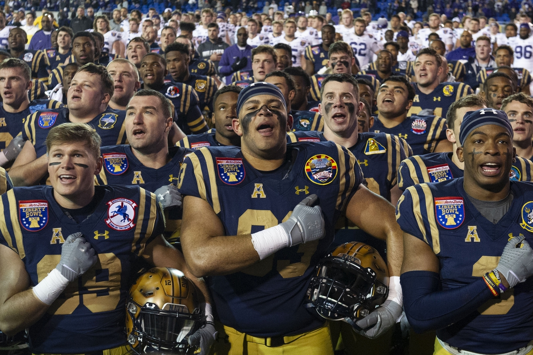 Dec 31, 2019; Memphis, Tennessee, USA; Navy Midshipmen players celebrate after the game against the Kansas State Wildcats at Liberty Bowl Memorial Stadium. Mandatory Credit: Justin Ford-USA TODAY Sports