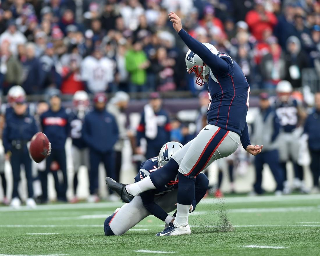 Dec 29, 2019; Foxborough, Massachusetts, USA; New England Patriots kicker Nick Folk (2) kicks an extra point during the second half against the Miami Dolphins at Gillette Stadium. Mandatory Credit: Bob DeChiara-USA TODAY Sports