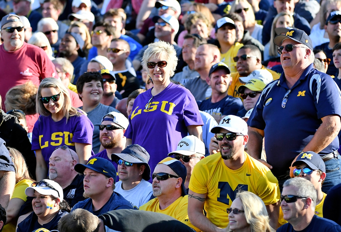 Jan 1, 2020; Orlando, Florida, USA; LSU Tiger fans watch the game between the Alabama Crimson Tide and the Michigan Wolverines during the second half at Camping World Stadium. Mandatory Credit: Jasen Vinlove-USA TODAY Sports