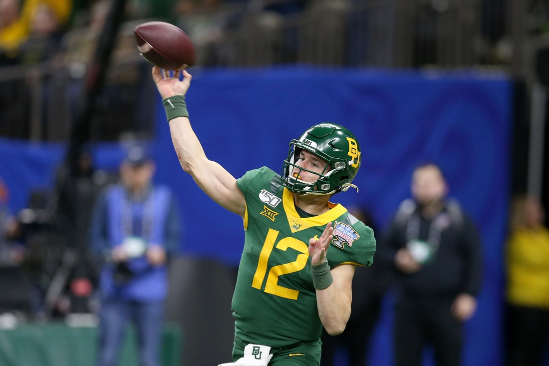 Jan 1, 2020; New Orleans, Louisiana, USA; Baylor Bears quarterback Charlie Brewer (12) makes a throw in the second half against the Georgia Bulldogs in the Sugar Bowl at the Mercedes-Benz Superdome. Mandatory Credit: Chuck Cook-USA TODAY Sports