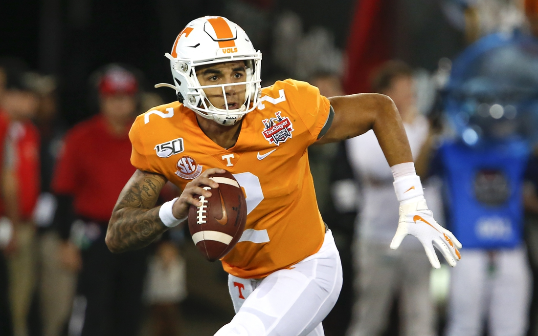 Jan 2, 2020; Jacksonville, Florida, USA; Tennessee Volunteers quarterback Jarrett Guarantano (2) runs with the ball during the first quarteagainst the Indiana Hoosiers in the 2020 Taxslayer Gator Bowl at TIAA Bank Field. Mandatory Credit: Reinhold Matay-USA TODAY Sports