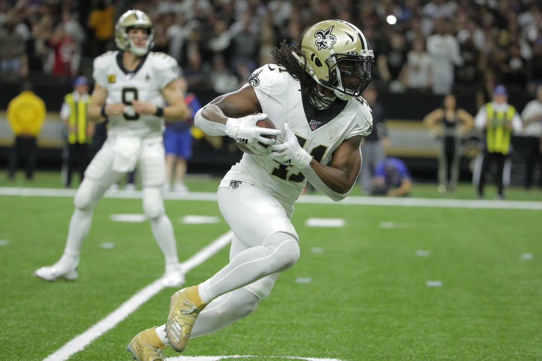 Jan 5, 2020; New Orleans, Louisiana, USA; New Orleans Saints running back Alvin Kamara (41) runs the ball for a touchdown against the Minnesota Vikings during the second quarter of a NFC Wild Card playoff football game at the Mercedes-Benz Superdome. Mandatory Credit: Derick Hingle-USA TODAY Sports