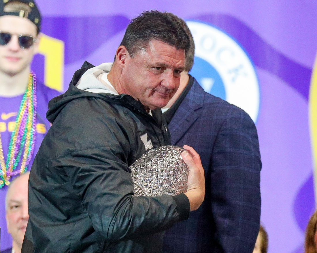 Jan 18, 2020; Baton Rouge, Louisiana, USA;  LSU Tigers head coach Ed Orgeron holds the AFCA Coaches' Trophy presented by Amway during the LSU championship trophy presentation at Pete Maravich Assembly Center. Mandatory Credit: Stephen Lew-USA TODAY Sports
