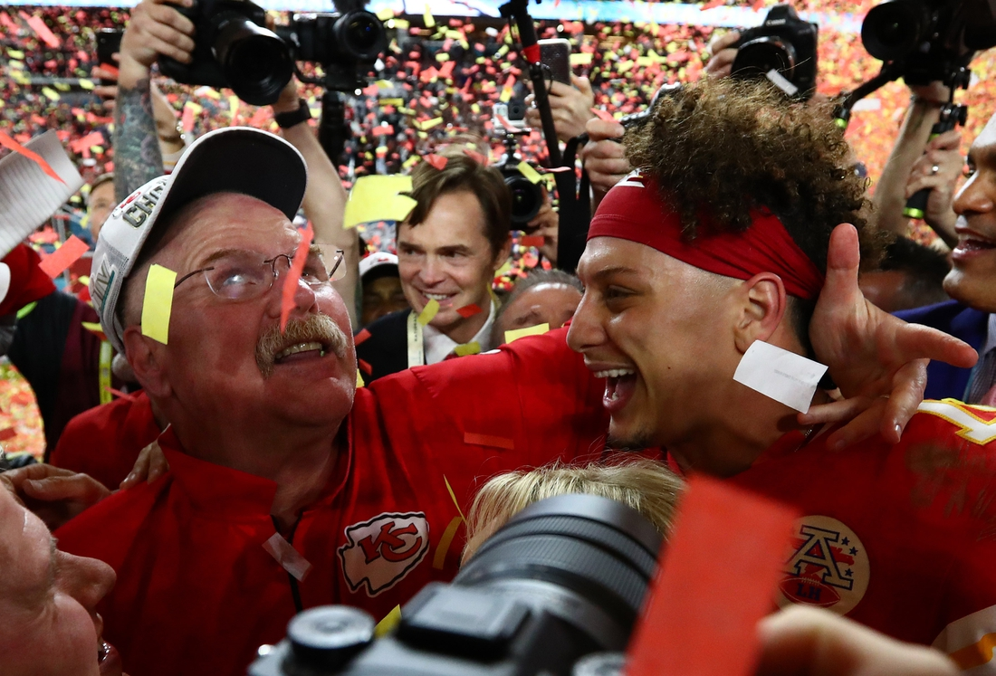 Feb 2, 2020; Miami Gardens, Florida, USA; Kansas City Chiefs head coach Andy Reid celebrates with quarterback Patrick Mahomes (15) after a victory against the San Francisco 49ers in Super Bowl LIV at Hard Rock Stadium. Mandatory Credit: Matthew Emmons-USA TODAY Sports