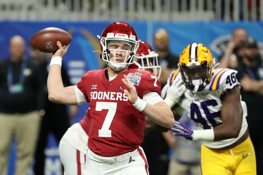 Dec 28, 2019; Atlanta, Georgia, USA; Oklahoma Sooners quarterback Spencer Rattler (7) attempts a pass during the 2019 Peach Bowl college football playoff semifinal game against the LSU Tigers at Mercedes-Benz Stadium. Mandatory Credit: Jason Getz-USA TODAY Sports