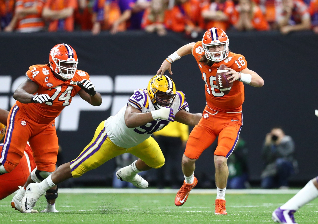 Jan 13, 2020; New Orleans, Louisiana, USA; Clemson Tigers quarterback Trevor Lawrence (16) against LSU Tigers defensive end Rashard Lawrence (90) in the College Football Playoff national championship game at Mercedes-Benz Superdome. Mandatory Credit: Mark J. Rebilas-USA TODAY Sports