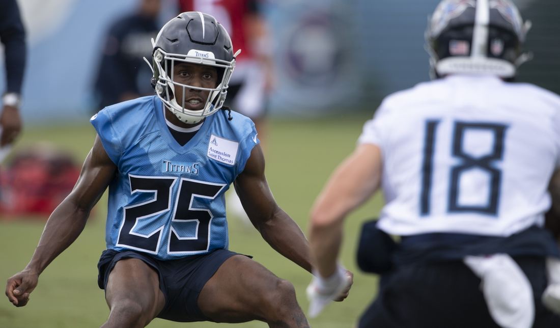 Aug 14, 2020; Glendale, AZ, USA;   Tennessee Titans cornerback Adoree' Jackson (25) looks to stop Tennessee Titans wide receiver Mason Kinsey (18) during a training camp practice at Saint Thomas Sports Park Friday, Aug. 14, 2020 in Nashville, Tenn.  Mandatory Credit: George Walker IV/The Tennessean-USA TODAY Sports