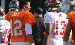 Aug 17, 2020; Tampa, Florida, USA;  Tampa Bay Buccaneers quarterback Tom Brady (12) and wide receiver Mike Evans (13) talk at AdventHealth Training Center. Mandatory Credit: Kim Klement-USA TODAY Sports