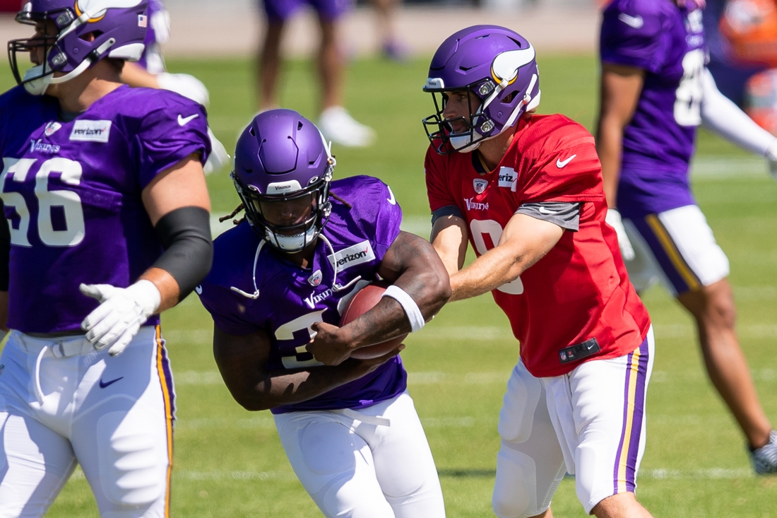 Aug 18, 2020; Eagan, Minnesota, United States; Minnesota Vikings quarterback Kirk Cousins (8) hands the ball off to running back Dalvin Cook (33) at training camp at TCO Performance Center. Mandatory Credit: Brad Rempel-USA TODAY Sports