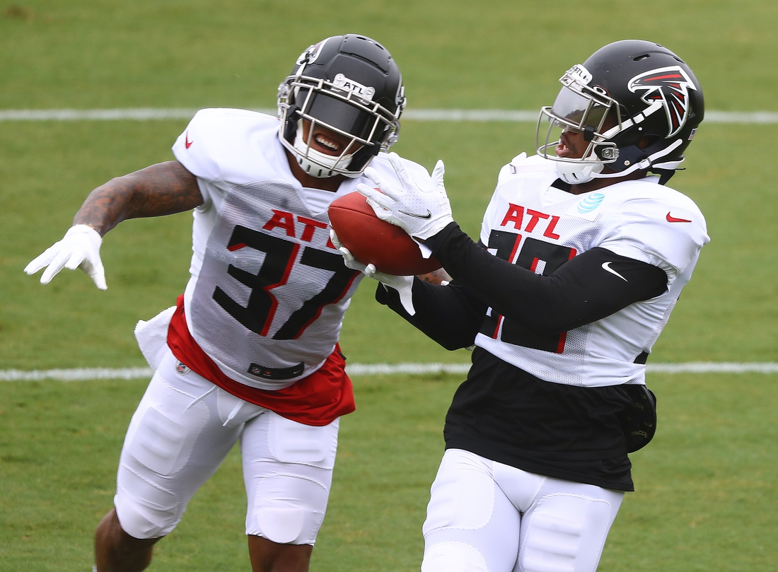 Aug 22, 2020; Flowery Branch, Georgia, USA; Atlanta Falcons safety Ricardo Allen (left) defends against cornerback Darqueze Dennard (right) during a defensive drill at training camp at the Falcons training facility. Mandatory Credit: Curtis Compton/Pool Photo-USA TODAY Sports