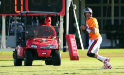 Aug 27, 2020; Tampa, Florida, USA;  Tampa Bay Buccaneers quarterback Tom Brady (12) throws the ball as  head coach Bruce Arians looks on at AdventHealth Training Center. Mandatory Credit: Kim Klement-USA TODAY Sports