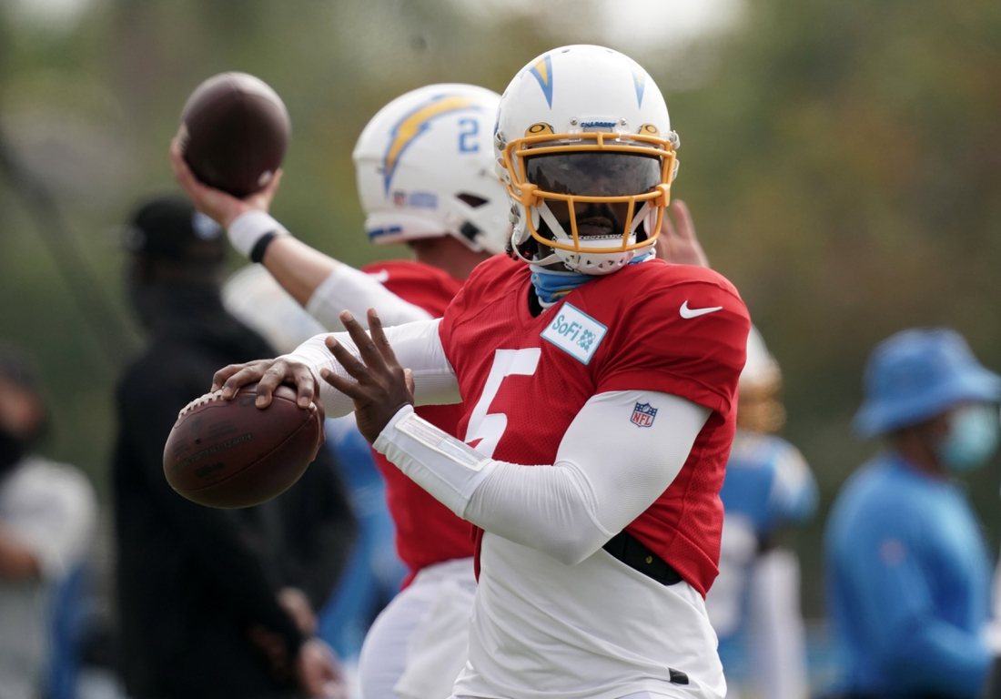 Aug 30, 2020; Los Angeles, California, United States; Los Angeles Chargers quarterback Tyrod Taylor (5) throws the ball during training camp at the Jack Hammett Sports Complex. Mandatory Credit: Kirby Lee-USA TODAY Sports