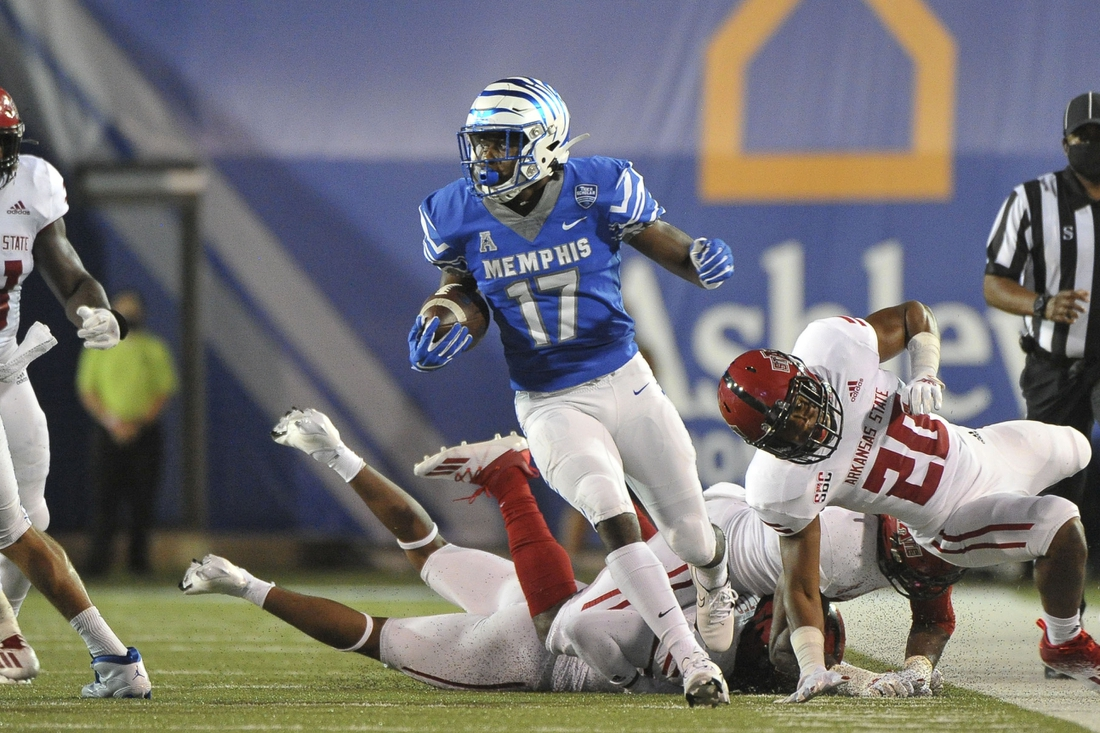 Sep 5, 2020; Memphis, Tennessee, USA; Memphis Tigers running back Kylan Watkins (17) carries the ball against Arkansas State Red Wolves defensive back Detravion Green (20) during the first half at Liberty Bowl Memorial Stadium. Mandatory Credit: Justin Ford-USA TODAY Sports