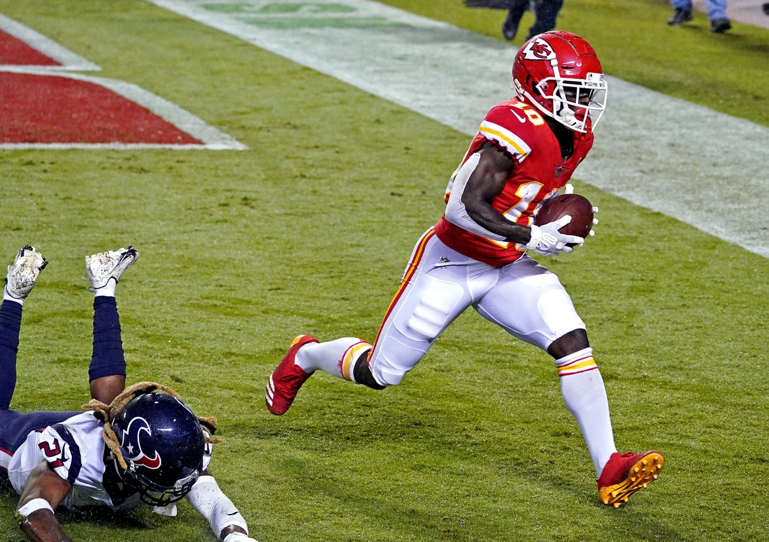 Sep 10, 2020; Kansas City, Missouri, USA; Kansas City Chiefs wide receiver Tyreek Hill (10) scores a touchdown against Houston Texans cornerback Bradley Roby (21) during the second half at Arrowhead Stadium. Mandatory Credit: Denny Medley-USA TODAY Sports