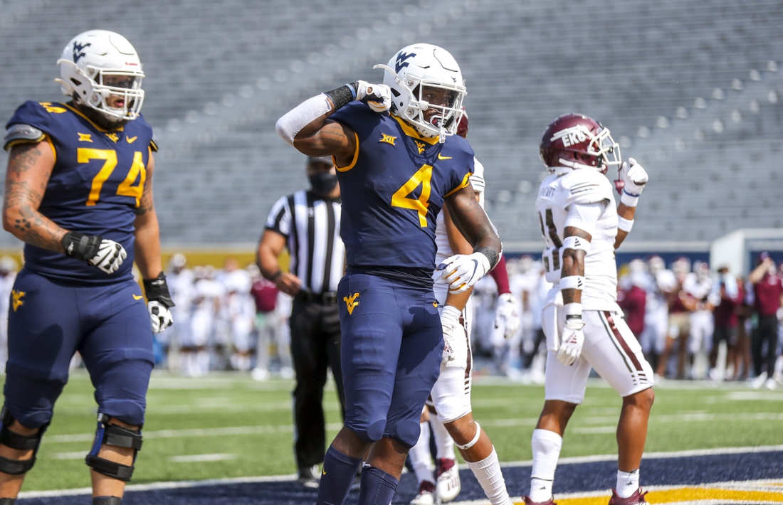 Sep 12, 2020; Morgantown, West Virginia, USA; West Virginia Mountaineers running back Leddie Brown (4) celebrates after running for a touchdown during the first quarter against the Eastern Kentucky Colonels at Mountaineer Field at Milan Puskar Stadium. Mandatory Credit: Ben Queen-USA TODAY Sports