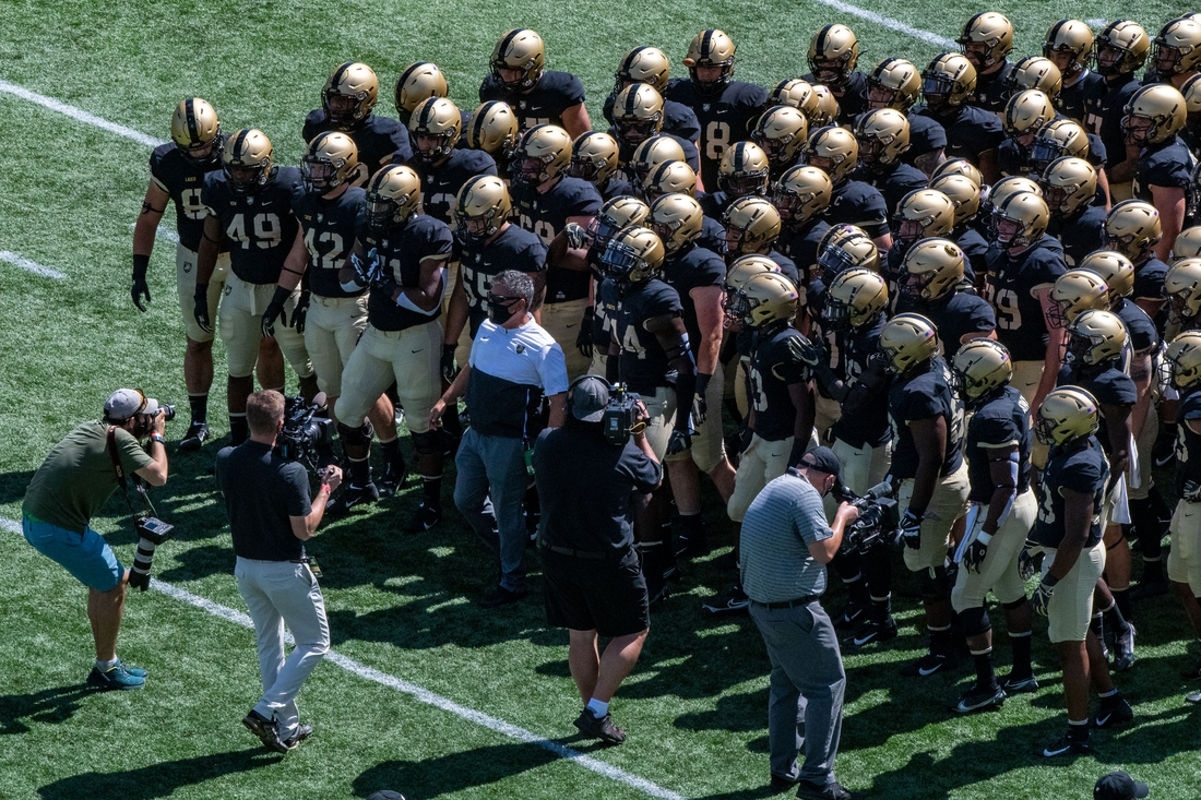 Sep 12, 2020; West Point, New York, USA; Army Black Knights head coach Jeff Monken (center in white) leads his team onto the field as they host the Louisiana Monroe Warhawks at Michie Stadium. Mandatory Credit: John Jones-USA TODAY Sports