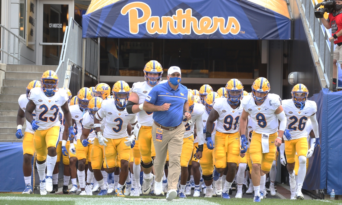 Sep 12, 2020; Pittsburgh, Pennsylvania, USA;  Pittsburgh Panthers head coach Pat Narduzzi (middle) leads his team onto the field to play the Austin Peay Governors against at Heinz Field. Mandatory Credit: Charles LeClaire-USA TODAY Sports