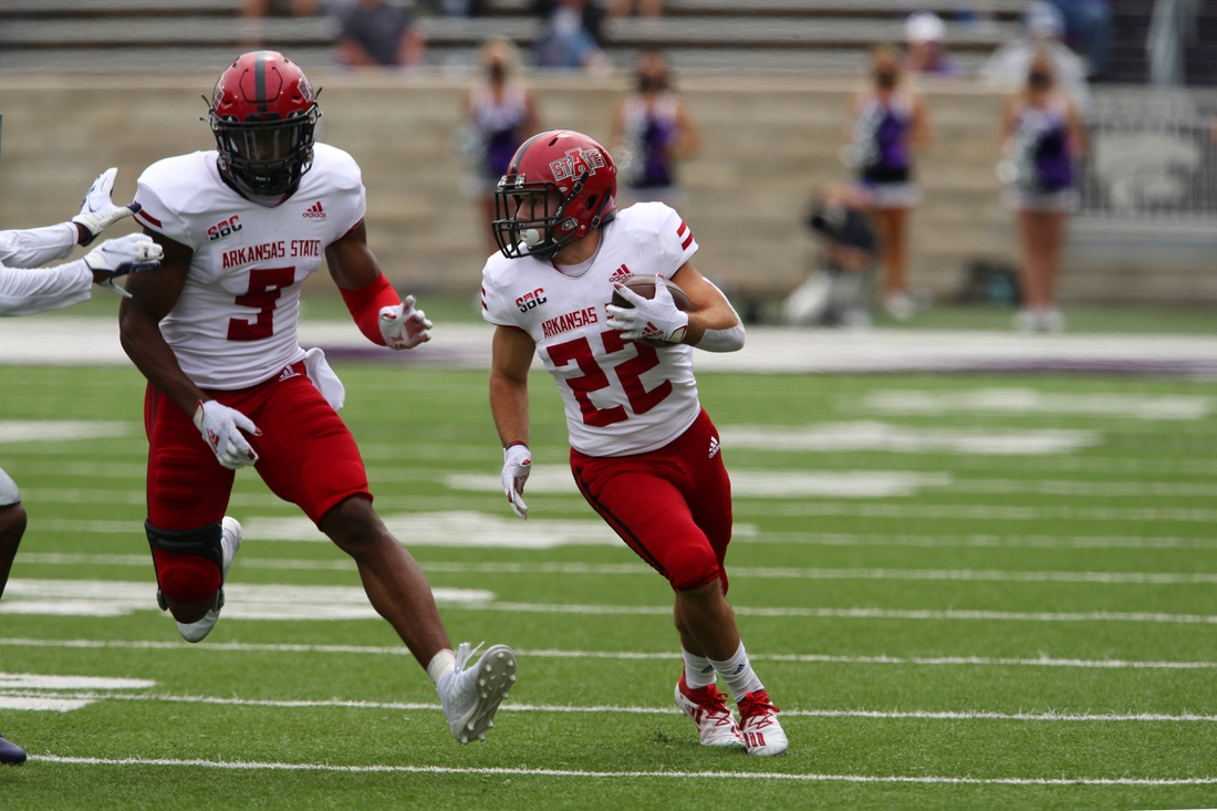 Sep 12, 2020; Manhattan, Kansas, USA; Arkansas State Red Wolves running back Lincoln Pare (22) follows the block of wide receiver Jonathan Adams Jr. (9) during a game against the Kansas State Wildcats at Bill Snyder Family Football Stadium. Mandatory Credit: Scott Sewell-USA TODAY Sports