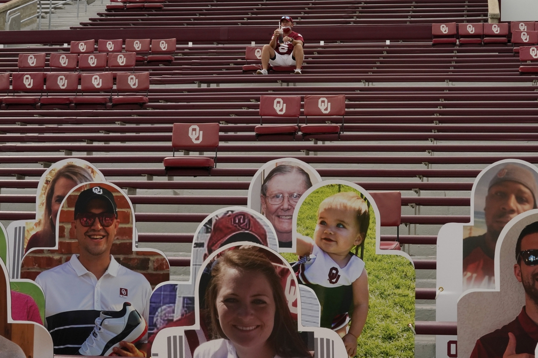 Sept 12, 2020, Norman, OK, USA; Fans use a touchless scanner for entrance to the Missouri State vs. Oklahoma NCAA college football game Saturday, Sept. 12, 2020, in Norman, Okla. Mandatory credit: Sue Ogrocki/Pool Photo via USA TODAY Sports
