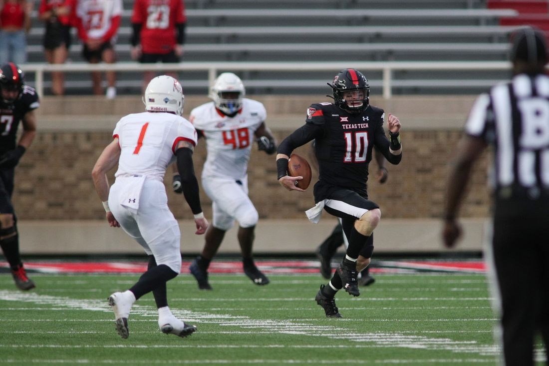 Sep 12, 2020; Lubbock, Texas, USA;  Texas Tech Red Raiders quarterback Alan Bowman (10) rushes for yards against the Houston Baptist Huskies in the first half at Jones AT&T Stadium. Mandatory Credit: Michael C. Johnson-USA TODAY Sports