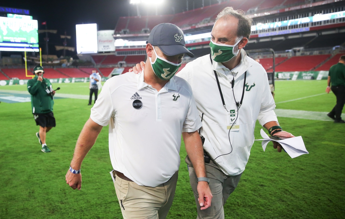 Sep 12, 2020; Tampa, Florida, USA; South Florida Bulls head coach Jeff Scott, left, celebrates with Associate Director of Athletics Brian Siegrist while walking off the field after the game against the Citadel Bulldogs at Raymond James Stadium. Mandatory Credit: Matt Stamey-USA TODAY Sports