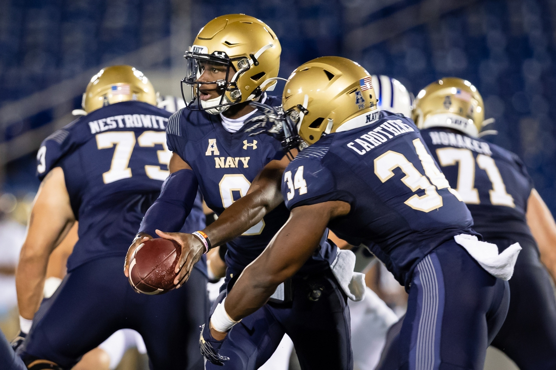 Sep 7, 2020; Annapolis, Maryland, USA; Navy Midshipmen quarterback Maasai Maynor (9) looks to hand the ball off to fullback Jamale Carothers (34) during the first half of the game against the Brigham Young Cougars at Navy-Marine Corps Memorial Stadium. Mandatory Credit: Scott Taetsch-USA TODAY Sports