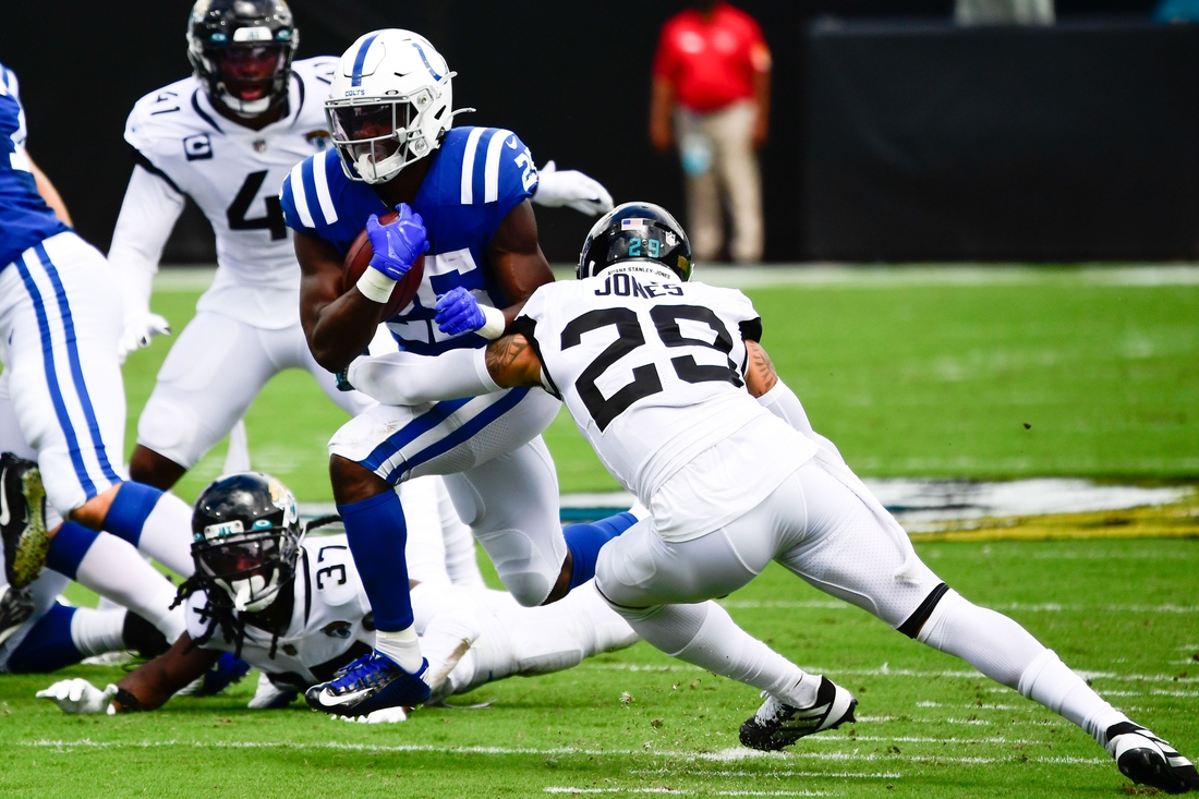 Sep 13, 2020; Jacksonville, Florida, USA; Indianapolis Colts running back Marlon Mack (25) runs with the ball as Jacksonville Jaguars safety Josh Jones (29) defends during the first quarter at TIAA Bank Field. Mandatory Credit: Douglas DeFelice-USA TODAY Sports