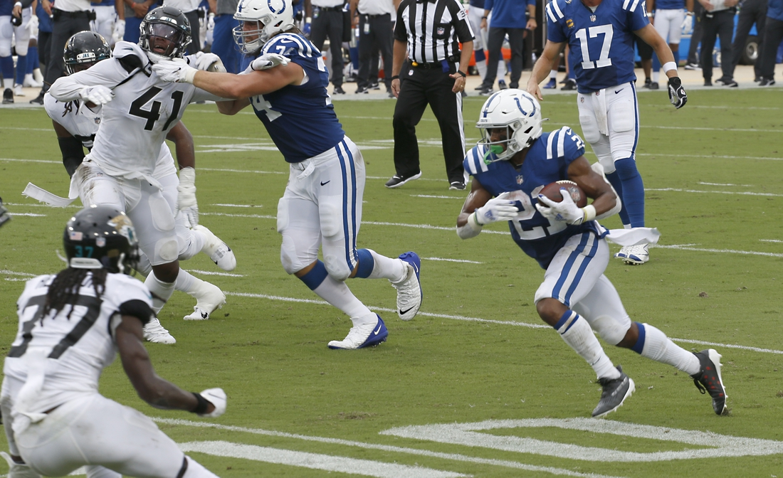 Sep 13, 2020; Jacksonville, Florida, USA;  Indianapolis Colts running back Nyheim Hines (21) runs for a touchdown as Jacksonville Jaguars cornerback Tre Herndon (37) comes up for the tackle while Jaguars defensive end Josh Allen (41) is blocked by Colts offensive tackle Anthony Castonzo (74) during the second quarter at TIAA Bank Field. Mandatory Credit: Reinhold Matay-USA TODAY Sports