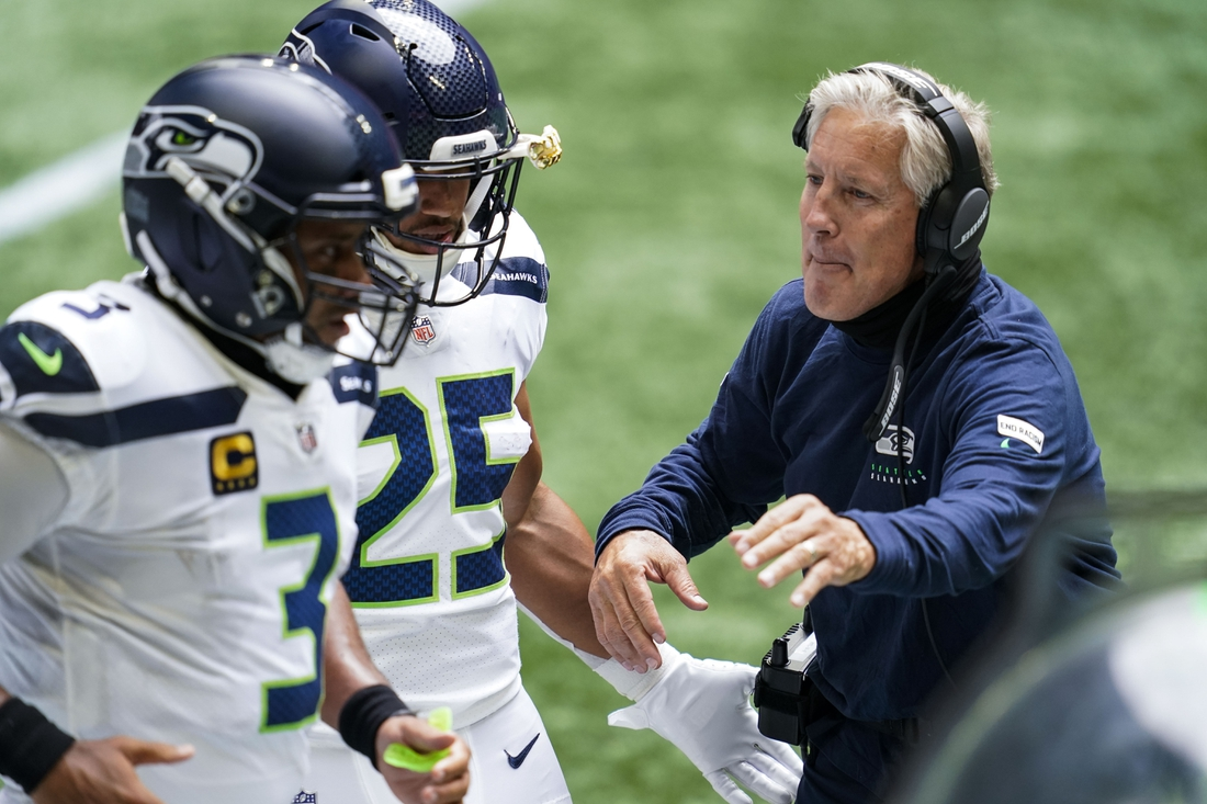 Sep 13, 2020; Atlanta, Georgia, USA; Seattle Seahawks head coach Pete Carroll reacts with players after a touchdown against the Atlanta Falcons during the first quarter at Mercedes-Benz Stadium. Mandatory Credit: Dale Zanine-USA TODAY Sports