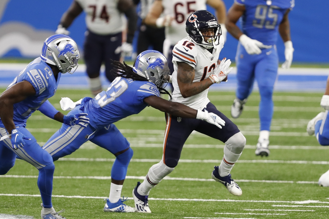 Sep 13, 2020; Detroit, Michigan, USA; Chicago Bears wide receiver Allen Robinson (12) runs after a catch against Detroit Lions cornerback Desmond Trufant (23) during the second quarter at Ford Field. Mandatory Credit: Raj Mehta-USA TODAY Sports