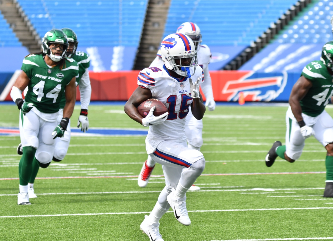 Sep 13, 2020; Orchard Park, New York, USA; Buffalo Bills wide receiver John Brown (15) scores a touchdown on a pass reception as New York Jets linebacker Harvey Langi (44) pursues during the second quarter at Bills Stadium. Mandatory Credit: Mark Konezny-USA TODAY Sports