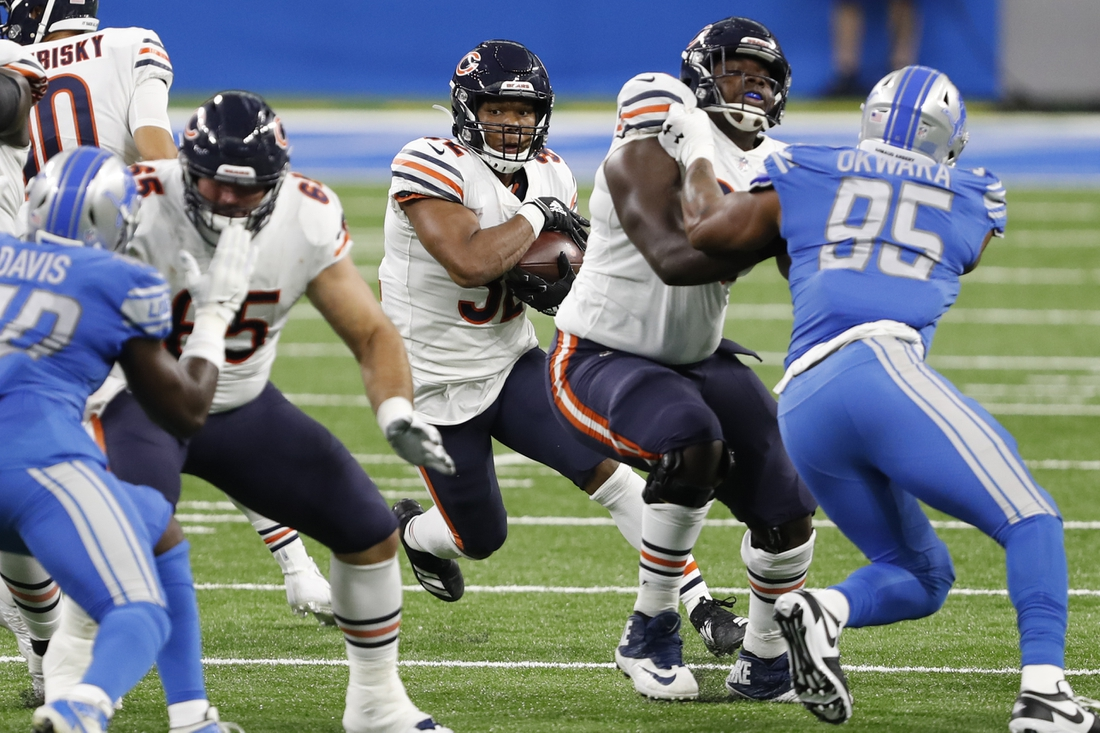 Sep 13, 2020; Detroit, Michigan, USA; Chicago Bears running back David Montgomery (32) runs the ball against the Detroit Lions during the second quarter at Ford Field. Mandatory Credit: Raj Mehta-USA TODAY Sports
