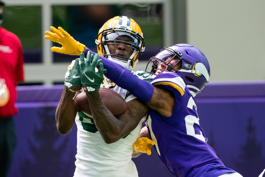 Sep 13, 2020; Minneapolis, Minnesota, USA; Green Bay Packers wide receiver Marquez Valdes-Scantling (83) catches a pass for a touchdown in the second quarter against the Minnesota Vikings defensive back Cameron Dantzler (27) at U.S. Bank Stadium. Mandatory Credit: Brad Rempel-USA TODAY Sports