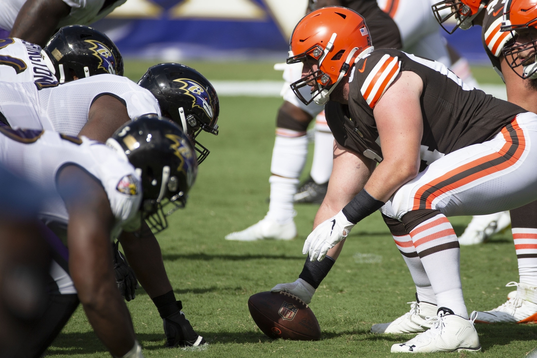 Sep 13, 2020; Baltimore, Maryland, USA;  Cleveland Browns center JC Tretter (64) snaps the ball against Baltimore Ravens in the fourth quarter at M&T Bank Stadium. Mandatory Credit: Leah Stauffer-USA TODAY Sports