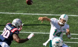 Sep 13, 2020; Foxborough, Massachusetts, USA; Miami Dolphins quarterback Ryan Fitzpatrick (14) passes the ball Ibn front of New England Patriots linebacker Shilique Calhoun (90) during the second half at Gillette Stadium. Mandatory Credit: Brian Fluharty-USA TODAY Sports
